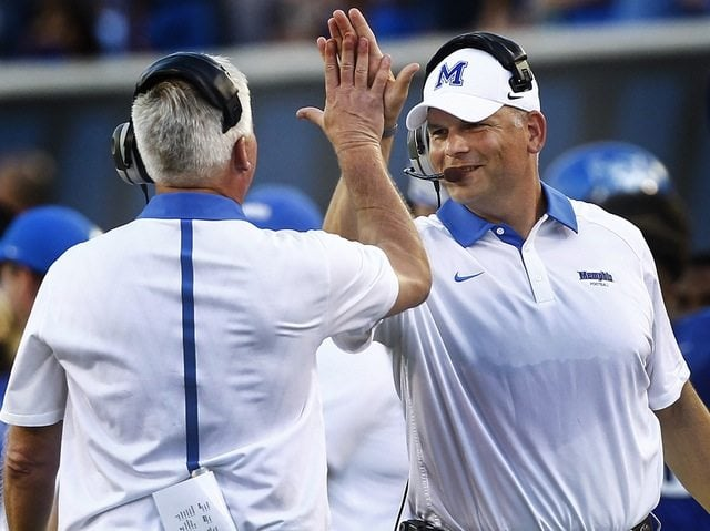 September 5, 2015 - Memphis head coach Justin Fuente (right) celebrates a touchdown with special teams coordinator James Shibest (left) against Missouri State during first quarter action at the Liberty Bowl Memorial Stadium Saturday, September 5, 2015 in Memphis Tenn. (AP Photo/The Commercial Appeal, Mark Weber)